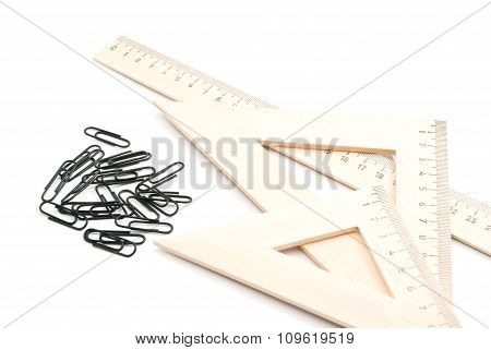 Wooden Ruler And Black Clips