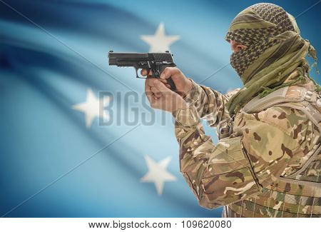 Male In Muslim Keffiyeh With Gun In Hand And National Flag On Background - Micronesia