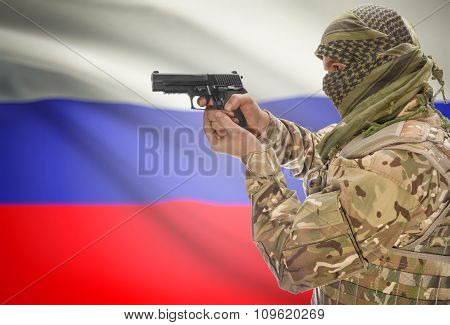 Male In Muslim Keffiyeh With Gun In Hand And National Flag On Background - Russia
