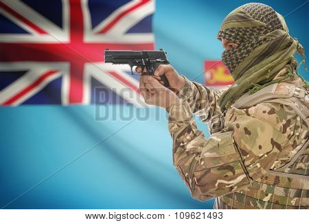 Male In Muslim Keffiyeh With Gun In Hand And National Flag On Background - Fiji