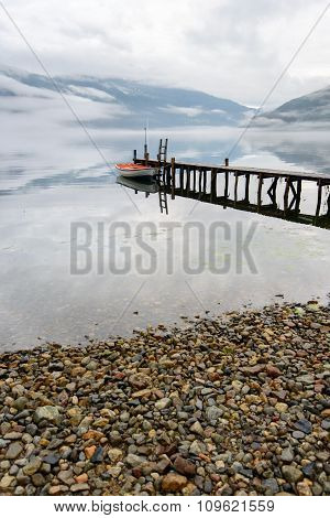 Boat near wooden pier in a norwegian lake