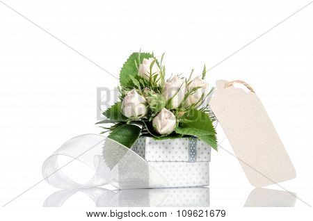 Gift Box And White Roses With Empty Tag For You Text On White Background