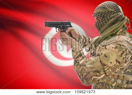 Male In Muslim Keffiyeh With Gun In Hand And National Flag On Background - Tunisia
