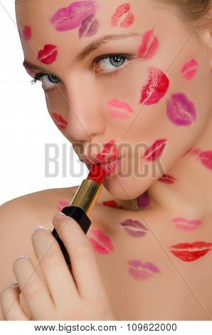 Woman With Kisses On Face In Lipstick And Lips