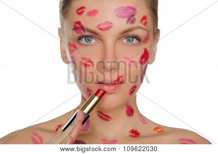 Charming Woman With Kisses On Face And Lipstick