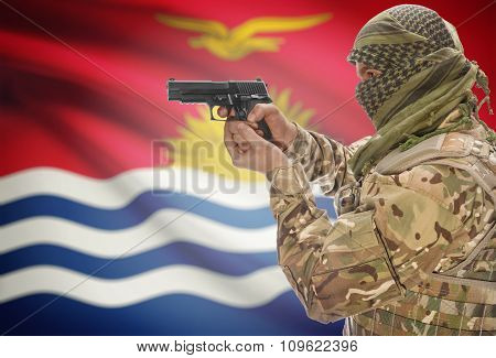 Male In Muslim Keffiyeh With Gun In Hand And National Flag On Background - Kiribati