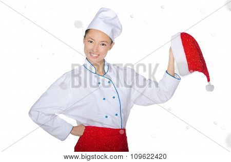 Happy Asian Chef With Christmas Cap In Snow