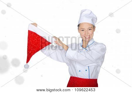Smiling Asian Chef With Christmas Cap In Snow