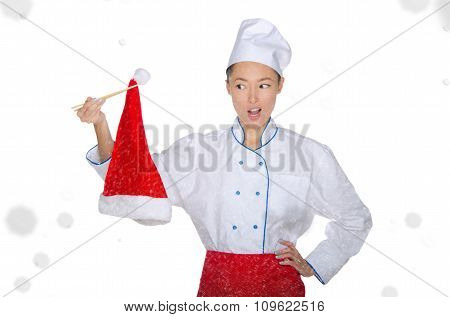 Surprised Asian Chef In Christmas Cap With Chopsticks Under Snow
