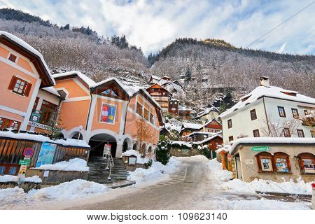 HALLSTATT, AUSTRIA : JANUARY 2015 : Buildings on the hill at Hallstatt village along the Hallstaetter lake in Austria during winter on January 2, 2015