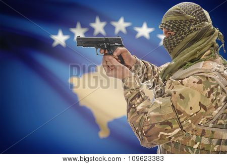 Male In Muslim Keffiyeh With Gun In Hand And National Flag On Background - Kosovo