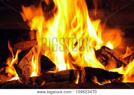 A nice fire with coals in a fire place close
