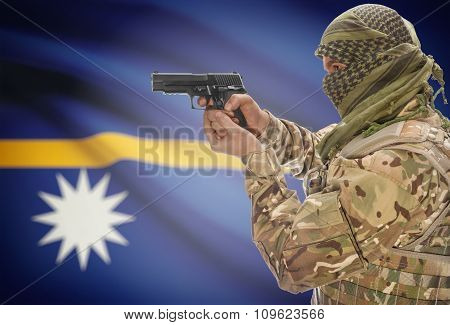 Male In Muslim Keffiyeh With Gun In Hand And National Flag On Background - Nauru