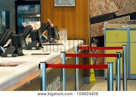 DUBAI, UAE - NOVEMBER 16, 2015: interior of McDonald's restaurant in Dubai Airport. Dubai International Airport is the world's busiest airport by international passenger traffic.