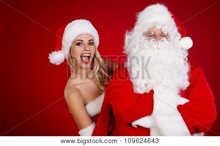 Santa Claus with a beautiful woman Christmas helper