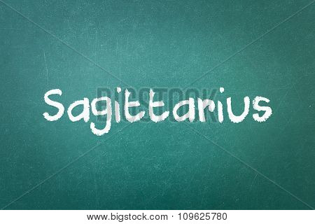 Green Blackboard Wall Texture With A Word Sagittarius