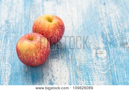 Red Apple On The Wooden Floor.
