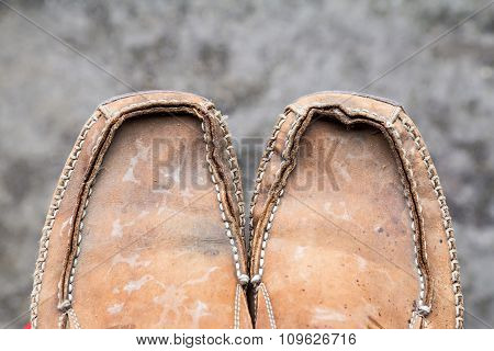 Old Leather Shoes On Blurred Background