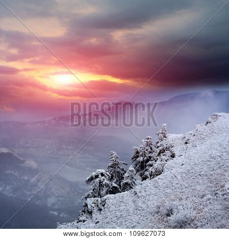 sunset scene in winter mountains