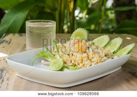 Shrimp Fried Rice,grass Water On Wooden Floor.
