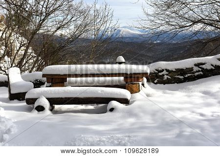 The bench and table in the beautiful snow