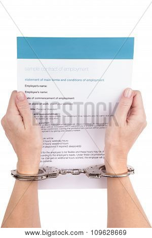 Female Hands In Handcuffs
