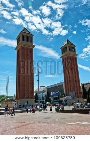 BARCELONA, SPAIN - MAY 01: Twin Venetian Towers Surrounded by Tourists in Plaza de Espana on Bright Sunny Day, Barcelona, Spain. May 01, 2015