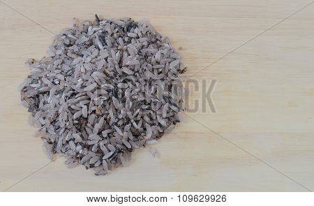 Rice Berries Placed On Wooden Floor.