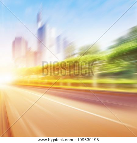 Motion blurred road in the city at sunset.