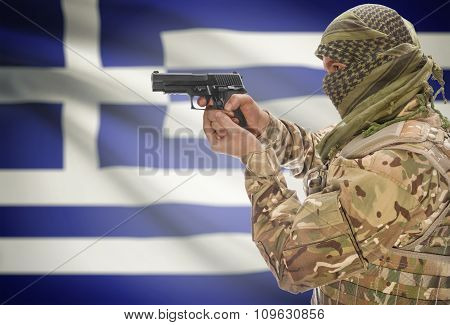 Male With Gun In Hand And National Flag On Background - Greece