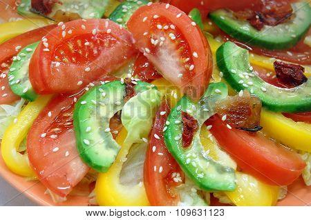 Tomato, avocado, pepper and sesame close-up