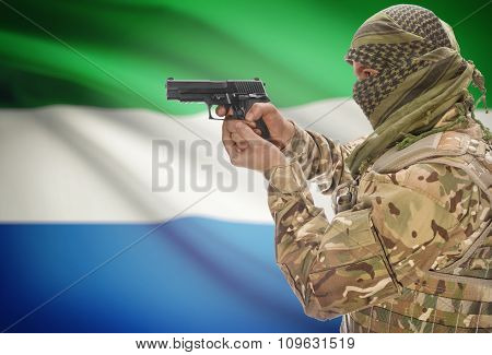 Male With Gun In Hand And National Flag On Background - Sierra Leone