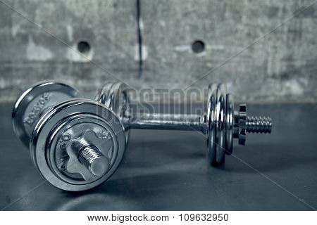 Two metallic dumbell for a workout