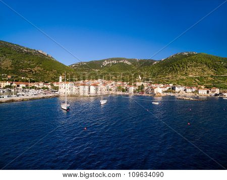 Boats in front of Komiza town on Vis Island, Croatia.