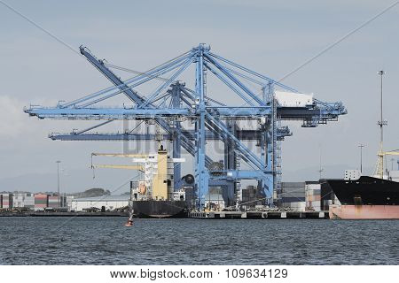 Large harbor cranes at the commercial dock in Panama city