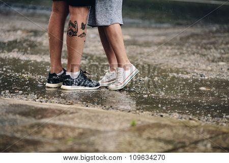 couple on the background of wet asphalt