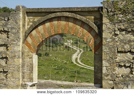 View Of Rural Road Through Arch