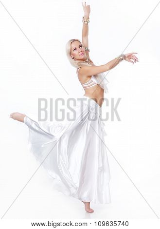 Belly  dancer in a white dress.