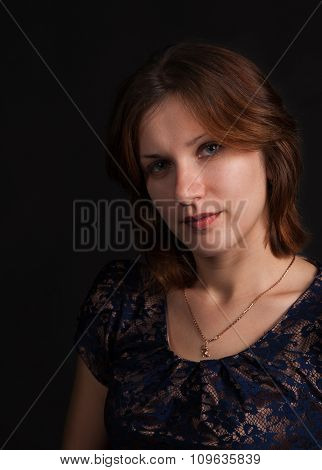 Young Beautiful Girl On A Dark Background
