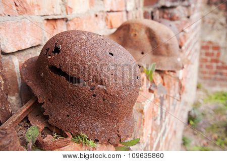 Two Old Rusty Military Helmets