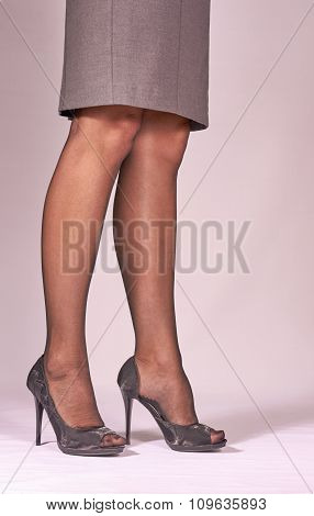slender woman legs with high heels