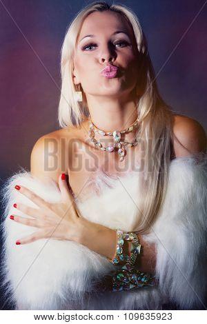 Beauriful woman in fur dress.