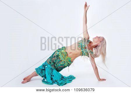 Belly  dancer in a green dress.