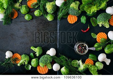 Fresh vegetables for a healthy diet on a dark background in a rustic style. Vegetarian food.