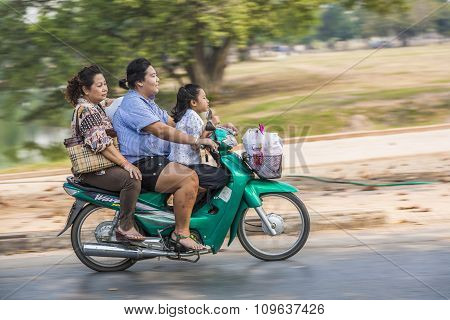 3 Woman Of Different Generations Ride On A Motorbike