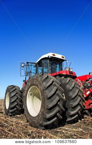 Powerful Agricultural Tractor In A Field