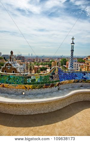 BARCELONA, SPAIN - MAY 02: Detail of the curving mosaic wall and benches with their colorful patterns on the terrace at the Parc Guell, Barcelona , Spain, designed by Antoni Gaudi. May 02, 2015