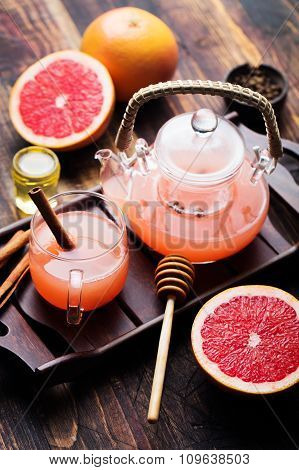 Grapefruit herbal tea with spices and honey