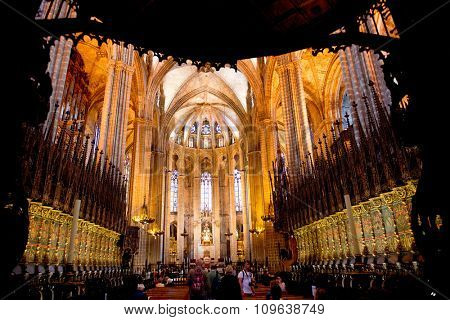 BARCELONA - MAY 02: Interior of Barcelona Cathedral Illuminated in Warm Lighting and Crowded with People, Barcelona, Spain. May 02, 2015