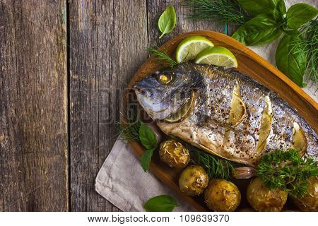 Baked Dorado With Spicy Herbs And Potatoes
